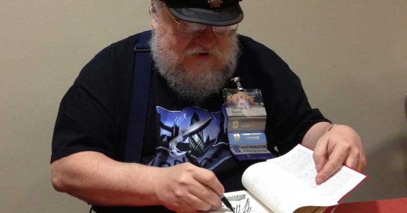 Goerge RR Martin signs a book for a fan